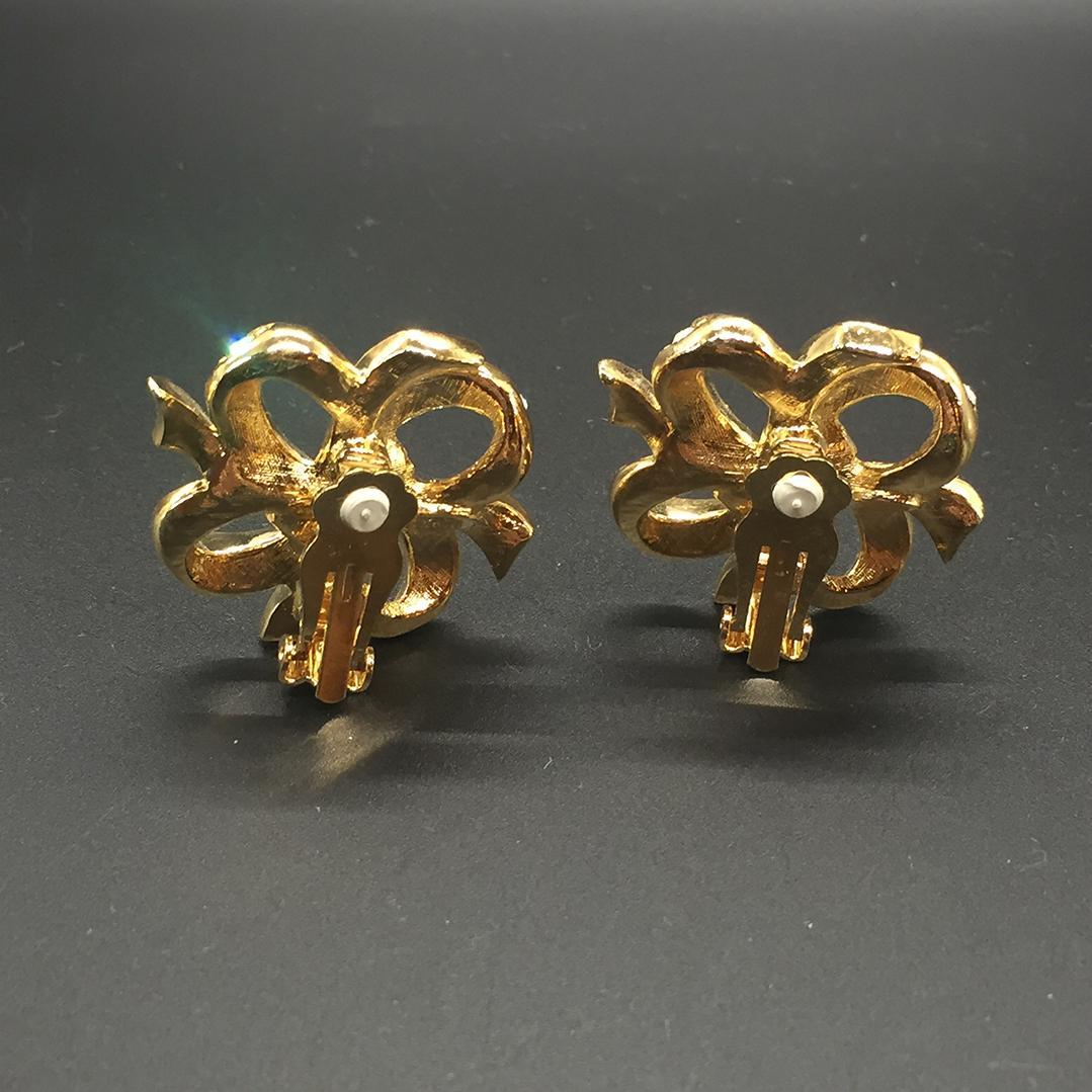 KJL gold tone ribbon rhinestone earrings